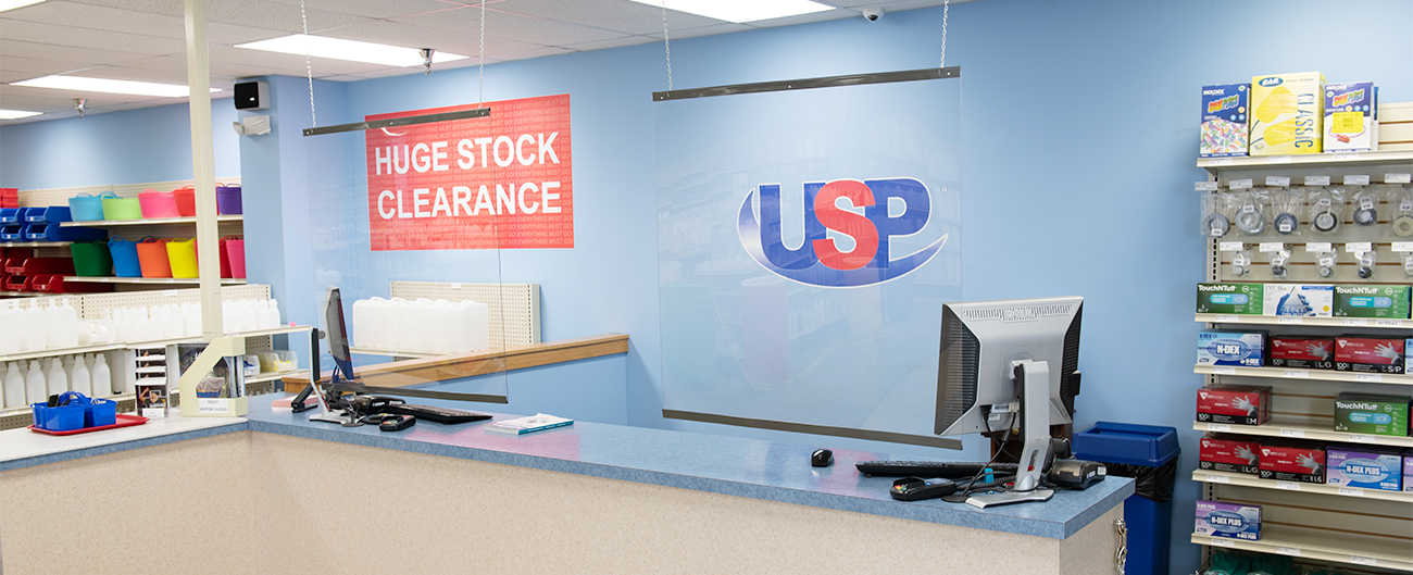 Cashier shields hung in the USP store