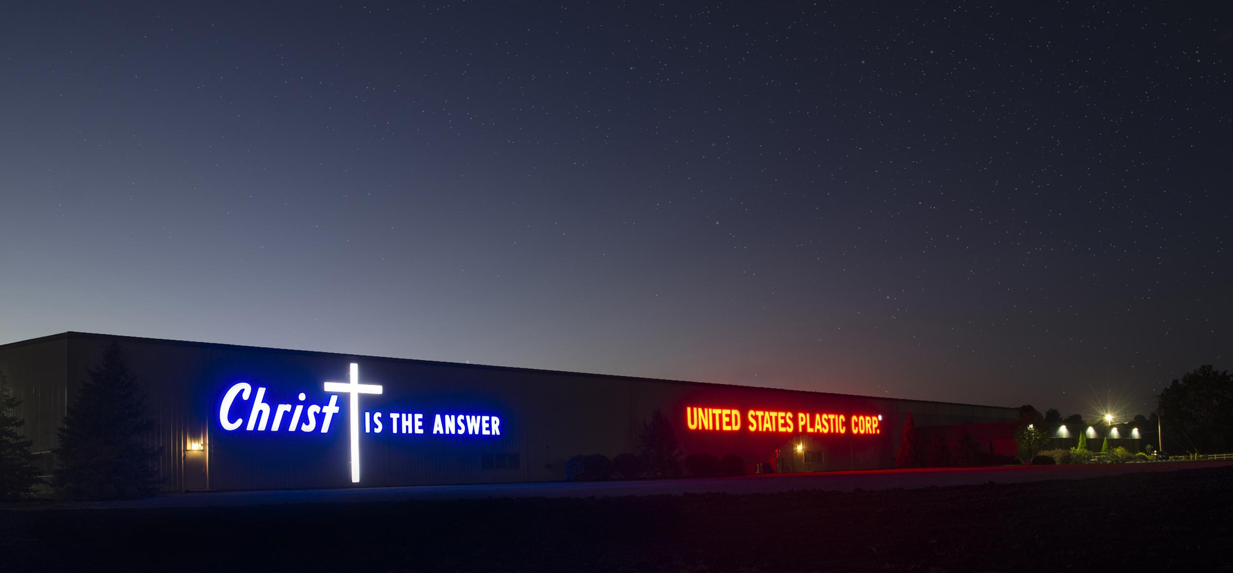 U.S. Plastic building at night
